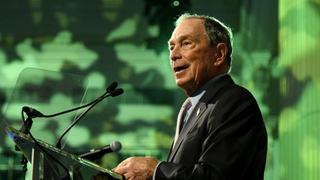 Michael Bloomberg speaking at a podium in October 2019