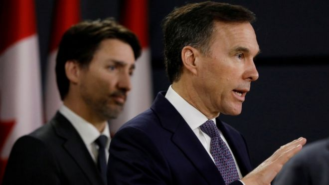 """Canada""""s Minister of Finance Bill Morneau attends a news conference with Prime Minister Justin Trudeau in Ottawa, Ontario, Canada March 11, 2020"""