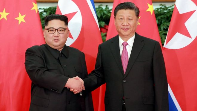 XI JINPING AND KIM JONGUN
