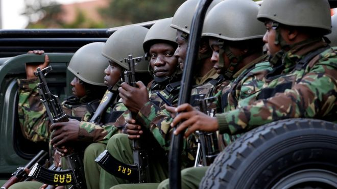 Kenyan police officers drive in their truck (file photo)