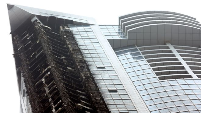 Damage to the Torch Tower is pictured after a fire engulfed the residential skyscraper in the Dubai Marina pictured on February 21, 2015