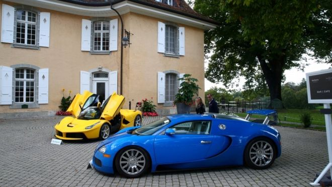 Luxury cars are displayed at an auction in the Swiss village of Cheserex, near Geneva