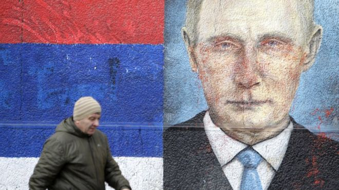 A man walks past a mural depicting Russian President Vladimir Putin in Belgrade, Serbia, 15 January 2019