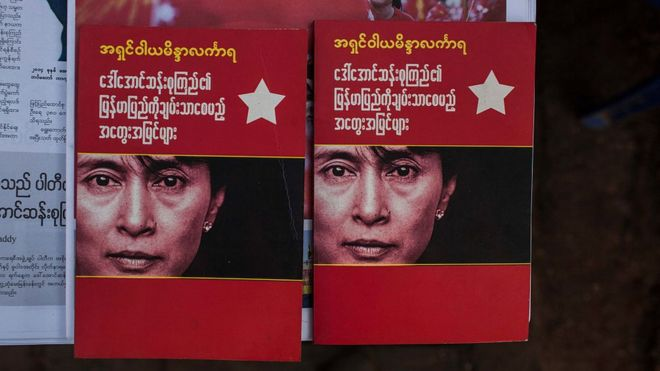 Booklets bearing Aung San Suu Kyi's face in Myanmar afterher party swept to victory in November 2015's election
