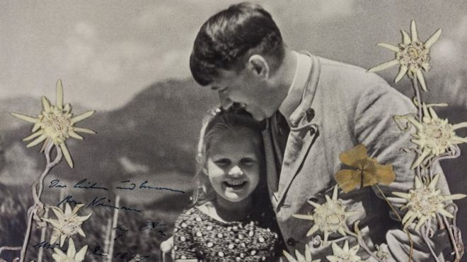 Adolf Hitler hugs Rosa Bernile Nienau in a signed picture