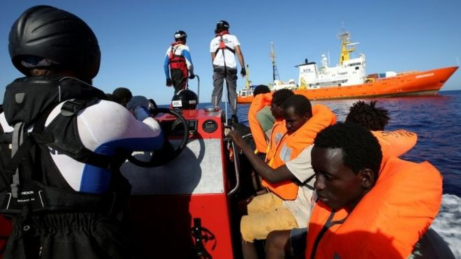 Migrants in life jackets are pictured during a rescue by the charity SOS Méditerranée