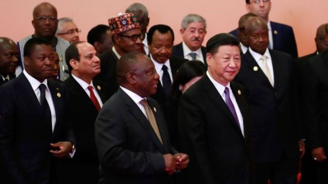 China's President Xi Jinping walks infront of African leaders