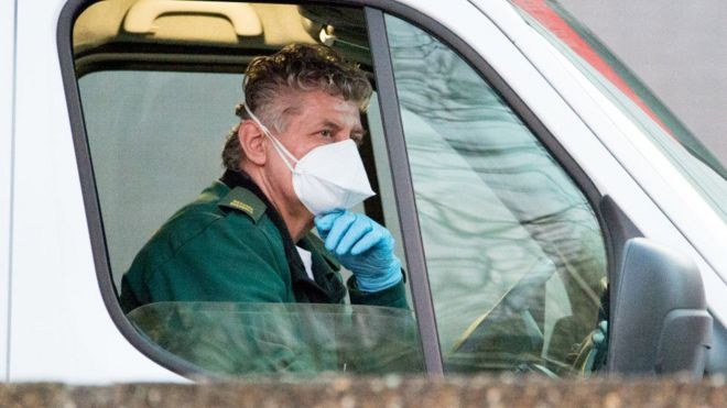 ambulance driver in mask