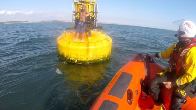 buoy rescue for porthcawl kayaker caught by tide bbc news