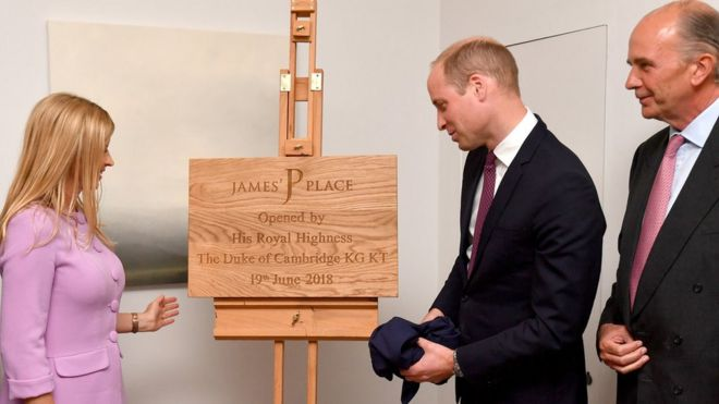 "Clare Milford Haven (left) looks-on as The Duke of Cambridge unveils a plaque during a visit to James"" Place in Liverpool"