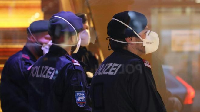 Police wearing masks at a hotel in Innsbruck, Austria