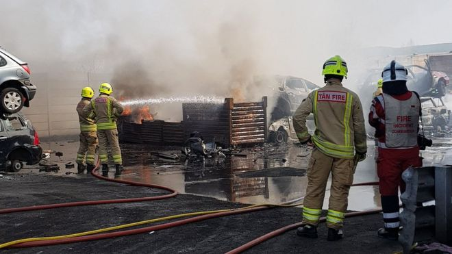 Swansea scrapyard car and tyre blaze tackled by crews - BBC News