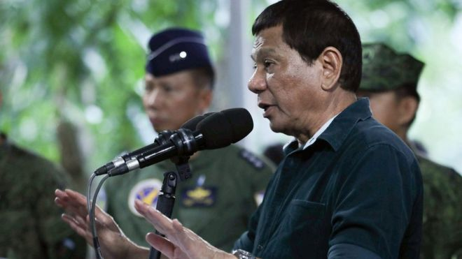 Rodrigo Duterte at a microphone