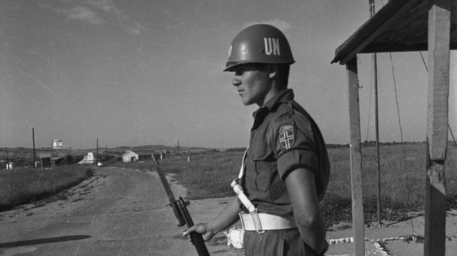 A United Nations Emergency Force officer manning a checkpoint on the border between Gaza and Israel, 1966