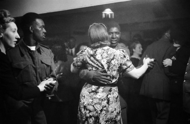 An african american gi dancing with a white girl at the bouillabaisse club in londons