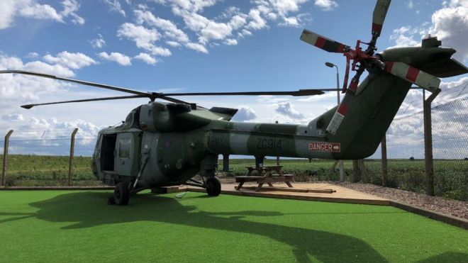 Helicopter converted into holiday pad at ex RAF bombing site - BBC News