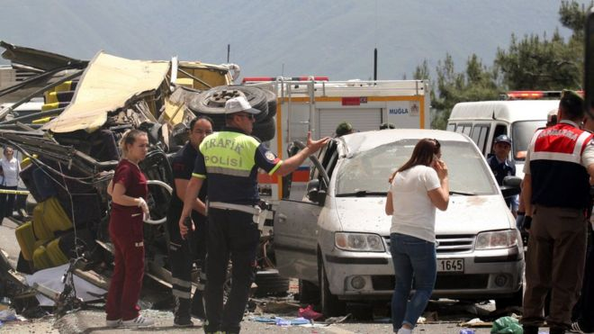 Medics and rescue workers stand at the scene after a tourist bus crashed near the southwestern holiday town of Marmaris, Turkey, May 13, 2017.