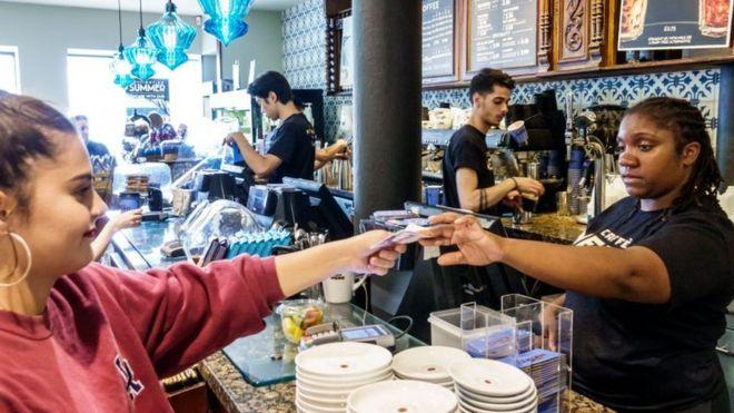 Woman working in coffee bar