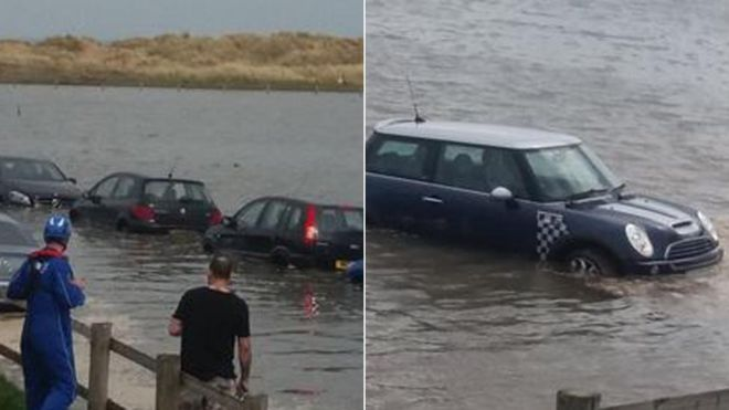 20 cars submerged after high tide at Talacre, Flintshire - BBC News