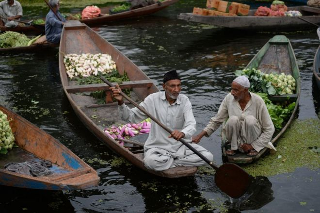 Kashmiri boatmen at the floating vegetable market on Dal lake in Srinagar