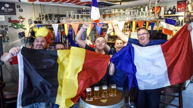 Belgian and French supporters gather at a cafe on July 9, 2018 near the French-Belgian border