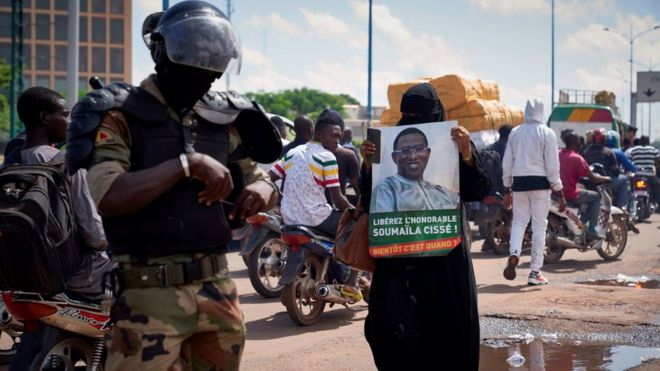 "A woman holds a sign reading ""Free Soumaila Cisse"" in Bamako on July 23, 2020"