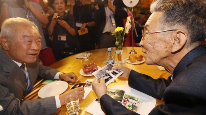 South Korean Kim Kwang-ho (L), 80, meets his North Korean brother Kim Kwang Il (R), 78