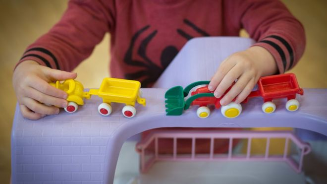 A young boy plays with toys at a playgroup