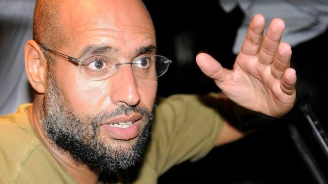 Saif Al-Islam, son of Libyan leader Muammar Gaddafi, gestures as he talks to reporters in Tripoli August 23, 2011