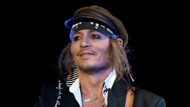 johnny depp settles lawsuit with former management bbc news