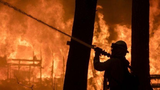 A firefighter battles the Camp Fire blaze in Paradise, California