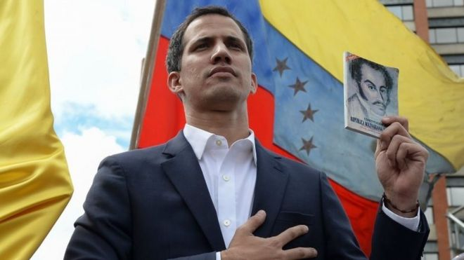 Image result for Juan Guaidó holds a copy of the constitution, pictures