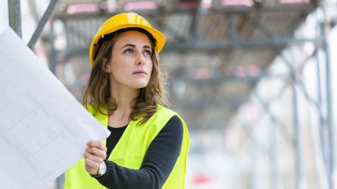 A young woman on a construction site