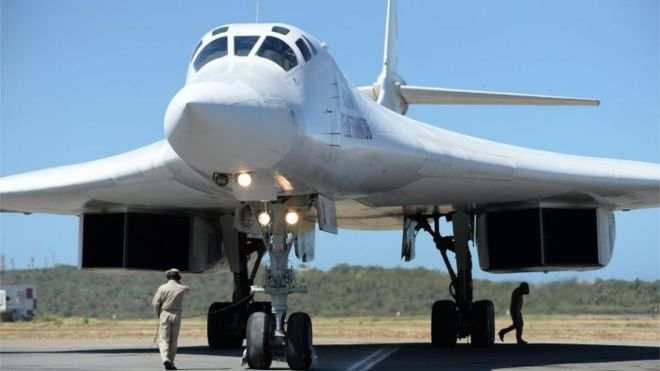 A Russian Tupolev Tu-160 strategic long-range heavy supersonic bomber aircraft is pictured upon landing at Maiquetia International Airport, just north of Caracas, on December 10, 2018