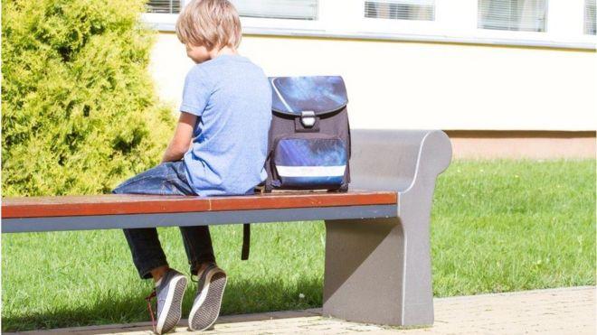 Sad boy on bench
