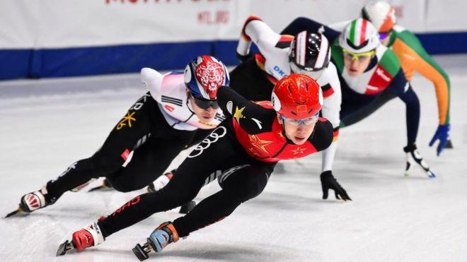 Ice skaters racing