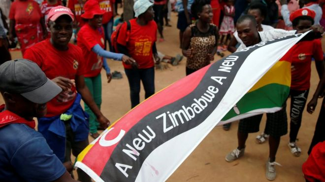 Opposition Movement for Democratic Change (MDC) party supporters wave flags at a rally to launch their election campaign in Harare, Zimbabwe, January 21, 2018.