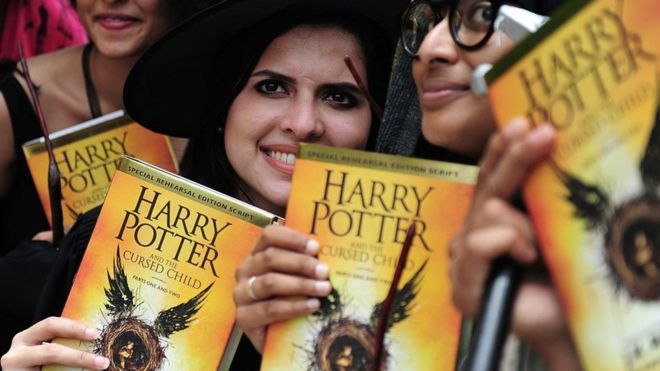 People holding Harry Potter books