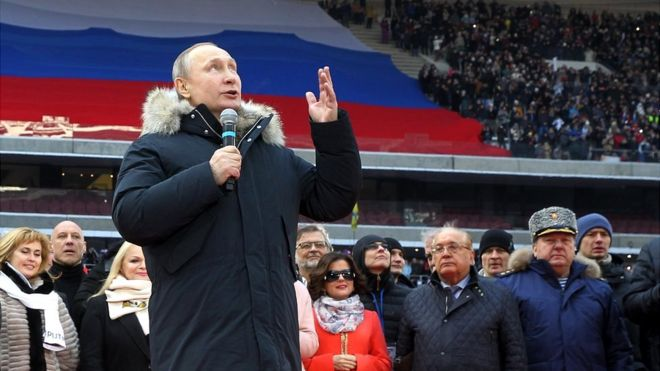 Russian President Vladimir Putin speaks during a campaign concert in March 2018