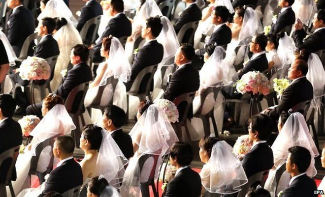 A View Of The Couples Sitting In Their Wedding Outfits At Venue