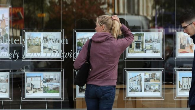 woman looking at houses for sale