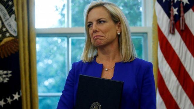 Former US Homeland Security Secretary Kirstjen Nielsen holding an executive order on immigration policy