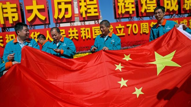 Chinese workers with Chinese flag
