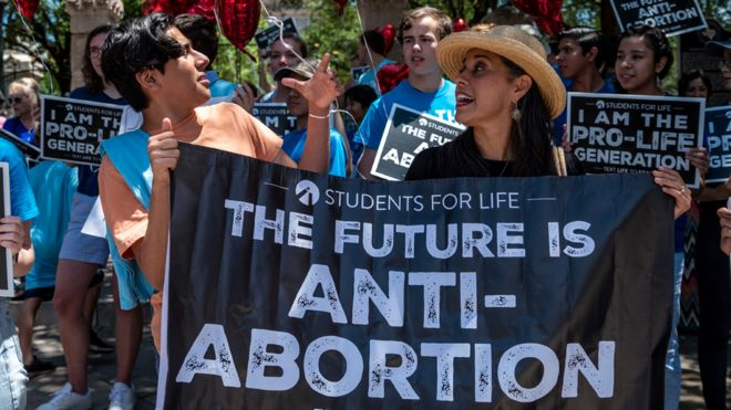 Pro-life protesters stand near the gate of the Texas state capitol at a protest outside the Texas state capitol on 29 May 2021 in Austin, Texas