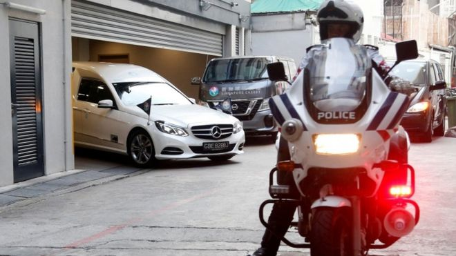 A hearse carrying the body of the late former Zimbabwe President Robert Mugabe leaves the funeral parlour for the airport in Singapore