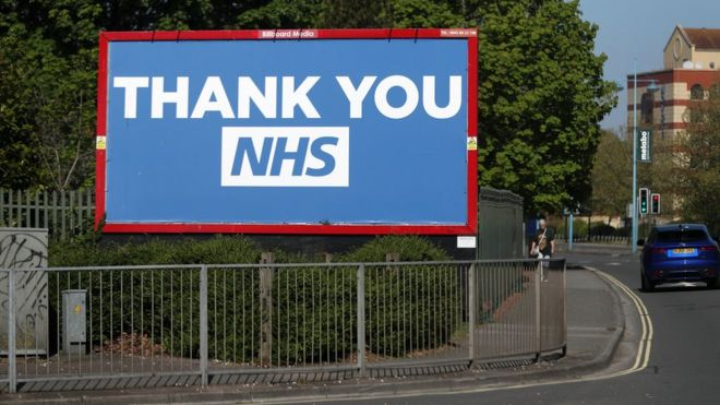 A billboard displaying a message in support of the NHS