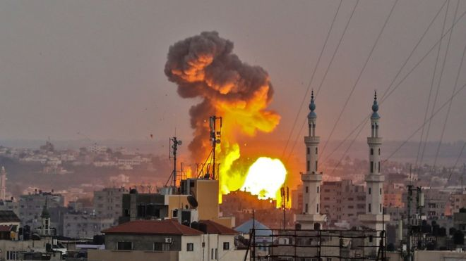 A picture taken on July 20, 2018 shows a fireball exploding in Gaza City during Israeli bombardment. Israeli aircraft and tanks hit targets throughout the Gaza Strip on July 20