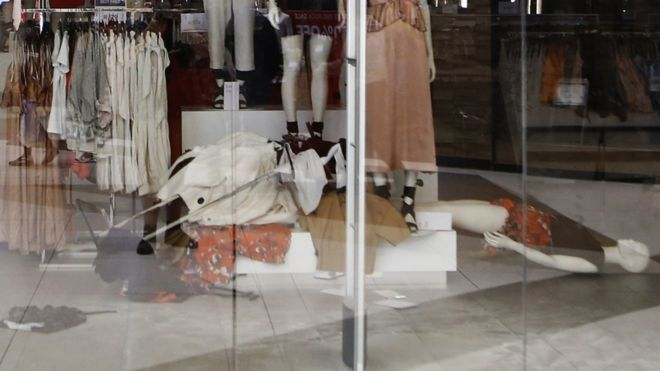 Clothes Racks And Mannequins Lie On The Floor Of An Hu0026M Store After It Was  Shut