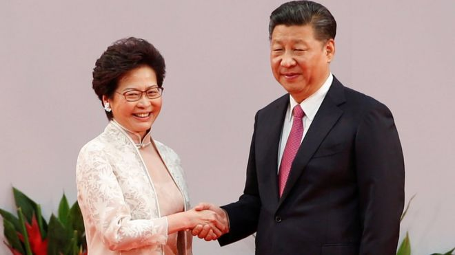 Hong Kong chief executive Carrie Lam shakes hands with Chinese President Xi Jinping after she swore an oath of office on the 20th anniversary of the city's handover from British to Chinese rule, in Hong Kong, China, 1 July 2017