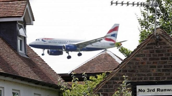 A British Airways plane approaches Heathrow